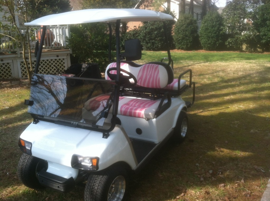 White Golf Cart with Pink Seats
